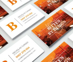 Bitten By Design - Business Cards on table